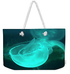 Weekender Tote Bag featuring the photograph moon Jellyfish 01 by Chris Flees