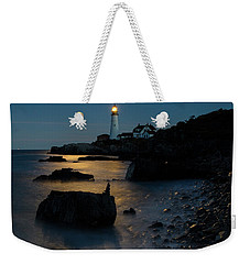 Weekender Tote Bag featuring the photograph Moon Light Over The Lighthouse  by Emmanuel Panagiotakis
