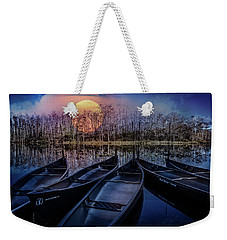 Weekender Tote Bag featuring the photograph Moon Rise On The River by Debra and Dave Vanderlaan