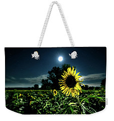 Weekender Tote Bag featuring the photograph Moonlighting Sunflower by Everet Regal