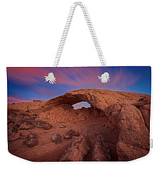Weekender Tote Bag featuring the photograph Moonrise Arch by Edgars Erglis