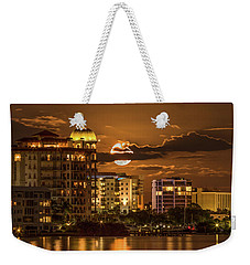 Weekender Tote Bag featuring the photograph Moonrise Over Sarasota by Richard Goldman