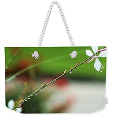 Weekender Tote Bag featuring the photograph Morning Rain Pearls by John Glass