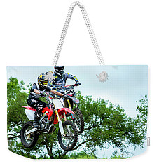 Weekender Tote Bag featuring the photograph Motocross Battle by David Morefield