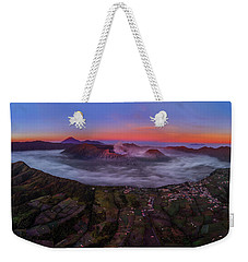 Weekender Tote Bag featuring the photograph Mount Bromo Misty Sunrise by Pradeep Raja Prints