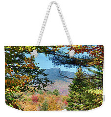 Weekender Tote Bag featuring the photograph Mount Mansfield Seen Through Fall Foliage by Jeff Folger