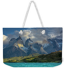 Weekender Tote Bag featuring the photograph Mountain Glimmer by Andrew Matwijec