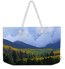 Weekender Tote Bag featuring the photograph Mountain Majesty by Broderick Delaney