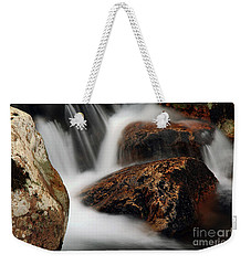 Weekender Tote Bag featuring the photograph Moving Along by Darren Fisher