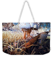 Weekender Tote Bag featuring the photograph Mushrooms In The Grass by Chriss Pagani