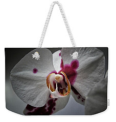 Weekender Tote Bag featuring the photograph My Growling Dragon Orchid. by Karen Stahlros