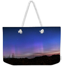 Weekender Tote Bag featuring the photograph Mystic Lights by Cat Connor