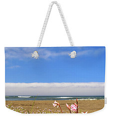 Weekender Tote Bag featuring the photograph Naked Ladies At The Beach by James Eddy