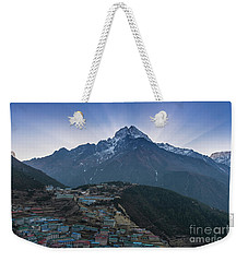 Weekender Tote Bag featuring the photograph Namche And Thamserku Peak Morning Sunrays by Mike Reid