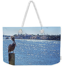 Weekender Tote Bag featuring the photograph Naples Pelican by Lars Lentz