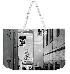 Weekender Tote Bag featuring the photograph Narrow Street And Bell Tower In Tavira - Portugal by Barry O Carroll