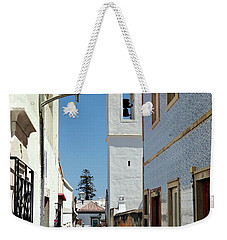 Weekender Tote Bag featuring the photograph Narrow Street In Tavira - Portugal by Barry O Carroll