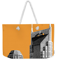 Nashville Skyline At And T Batman Building - Orange Weekender Tote Bag by DB Artist
