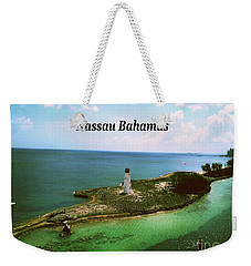 Weekender Tote Bag featuring the photograph Nassau by Gary Wonning