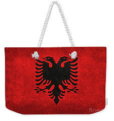 Weekender Tote Bag featuring the digital art National Flag Of Albania With Distressed Vintage Treatment  by Bruce Stanfield