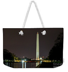 Weekender Tote Bag featuring the photograph National Mall At Night by Angela DeFrias