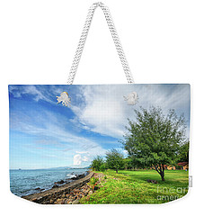 Weekender Tote Bag featuring the photograph Near The Shore by Charuhas Images