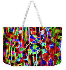 Weekender Tote Bag featuring the photograph Neon Gum by Spencer McDonald