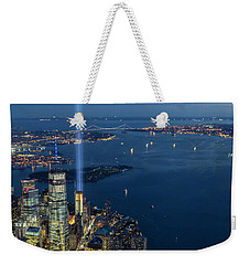Weekender Tote Bag featuring the photograph New York City Remembers 911 by Susan Candelario
