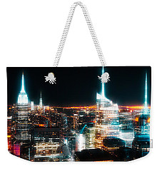 Weekender Tote Bag featuring the mixed media Night Glow New York City by Dan Sproul