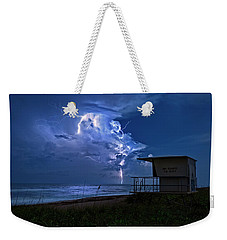 Weekender Tote Bag featuring the photograph Night Lightning Under Full Moon Over Hobe Sound Beach, Florida by Justin Kelefas