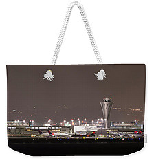 Weekender Tote Bag featuring the photograph Night Operations by Alex Lapidus