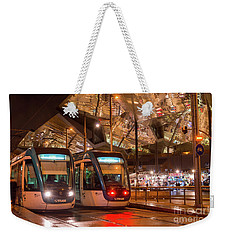 Night View Of Two Trams At Glories Station  Weekender Tote Bag
