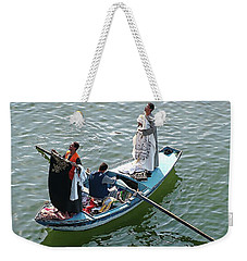 Weekender Tote Bag featuring the digital art Nile River Garment Vendors - Egypt by Joseph Hendrix