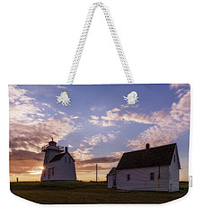 Weekender Tote Bag featuring the photograph North Rustico Lighthouse At Sunrise by Chris Bordeleau