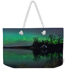 Weekender Tote Bag featuring the photograph Northern Lights At Gull Lake by Susan Rissi Tregoning