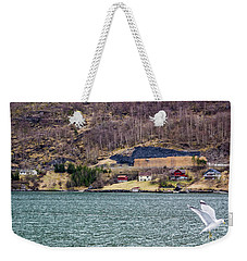 Weekender Tote Bag featuring the photograph Norwegian Village by Suzanne Luft