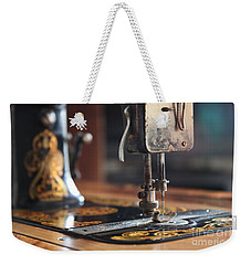 Weekender Tote Bag featuring the photograph Nostalgia ...vintage Neva Treadle Sewing Machine  by Lynn England