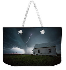 Weekender Tote Bag featuring the photograph Nowhere To Run by Aaron J Groen