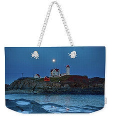 Weekender Tote Bag featuring the photograph Nubble Lighthouse Lit For Christmas by Jeff Folger