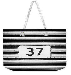 Weekender Tote Bag featuring the photograph Number 37 Metal Square by Terry DeLuco