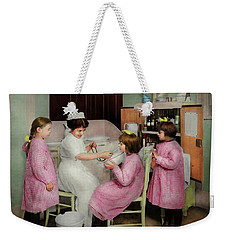 Weekender Tote Bag featuring the photograph Nurse - Playing Nurse 1918 by Mike Savad