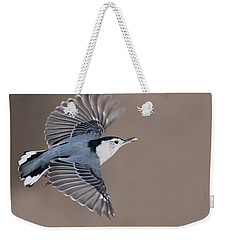 Weekender Tote Bag featuring the photograph Nuthatch In Flight by Mircea Costina Photography