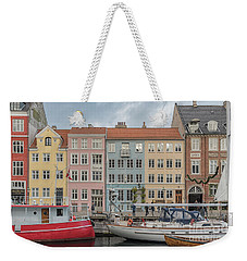Weekender Tote Bag featuring the photograph Nyhavn Waterfront In Copenhagen by Antony McAulay