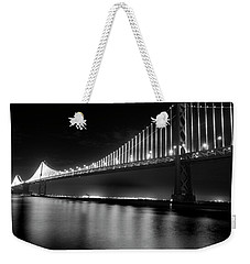 Weekender Tote Bag featuring the photograph Oakland Bay Bridge At Night by Darcy Michaelchuk