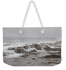 Weekender Tote Bag featuring the photograph Ocean Waves Over Rocks by Frank Stallone