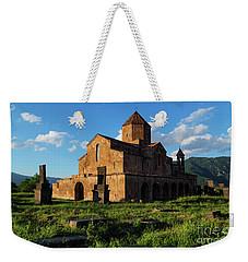 Odzun Church And Puffy Clouds At Evening, Armenia Weekender Tote Bag by Gurgen Bakhshetsyan