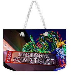 Weekender Tote Bag featuring the photograph Ogden's Historic 25th Street Neon Dragon Sign by Gary Whitton