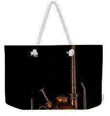 Weekender Tote Bag featuring the photograph Oil Cans by Paul Freidlund