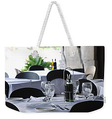 Weekender Tote Bag featuring the photograph Oils And Glass At Dinner by Rob Hans