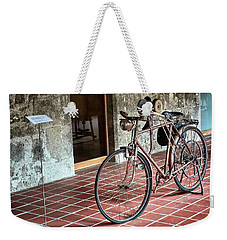 Weekender Tote Bag featuring the photograph Old Bicycle In The Monastery Of Santo Estevo De Ribas Del Sil by Eduardo Jose Accorinti